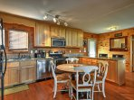 The kitchen is fully equipped with stainless steel appliances and expansive granite counterspace.