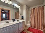 Wash up in the master en-suite, equipped with a shower/tub combo and a his-and-hers vanity.
