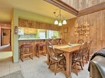 Enjoy meals at either the 6-person dining table or 4-person breakfast bar.