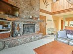 Relax in front of the wood-burning fireplace while watching the flat-screen cable TV.