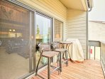 Lounge on the furnished balcony as you cook on the gas grill.
