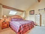 Create privacy in the master bedroom loft by closing the curtains.