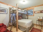 Lower level bedroom, full size bed and twin bunk.