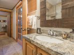 Lower level bathroom with walk-in shower.
