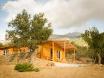 Charming wooden Eco-house in olive grove, surrounded by mountains, distant sea view