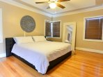 King bed with full length mirror in the second master suite!
