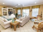 Graciously decorated living area, plenty of seating for the whole family.