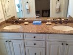 MASTER BATHROOM HAS DOUBLE SINKS, GRANITE COUNTER TOPS AND BATHTUB WITH SHOWER.