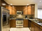 Granite counter tops and stainless appliances can be found in this beautiful kitchen