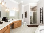 The master bathroom is expansive with a glass walk in shower, large soaker tub and dual vanities