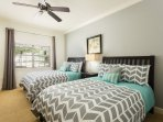 The third master bedroom is perfect for the kids with two twin beds