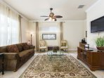 Gather around the TV in this luxurious living area