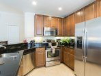 Granite counters and stainless appliances can be found in the kitchen.