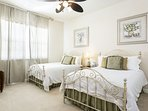 This bedroom is perfect for anyone.  A ceiling fan is offered as well as two beds.