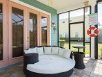 Relax with someone special or cozy up with a good book on the patio furniture