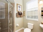 The second master bathroom has a glass enclosed tile shower with lots of natural light