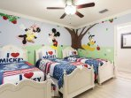 This themed room is a child's dream with 3 twin beds.