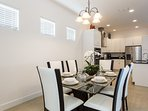 The dining room which is open into the kitchen offers seating for 6