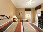Twin Bedroom with Flat Screen Television