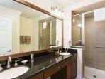 Master En-Suite with twin vanity sinks and granite surfaces