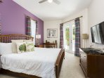 Stylish downstairs King master bedroom with ensuite and French doors with access to pool patio area