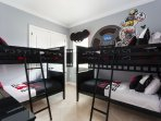 The kids will love staying in this Mickey themed room with double bunk beds.