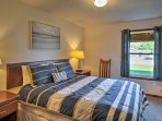 The master bedroom features a queen-sized bed and en-suite bath.