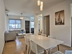 Enjoy home-cooked meals around 6-person dining table.