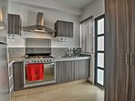 In the fully equipped kitchen, you'll find high-end appliances.