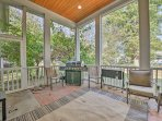 The outdoor space provides access to ample outdoor seating, a gas grill, and a large backyard.