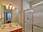 Get a refreshing start to the day in the full bathroom.