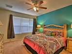 This bedroom features vibrant decor and a king bed.