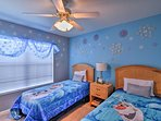 Cozy up to Olaf for a restful nights sleep in this frozen themed room with 2 twin beds!