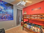 Drift off into dreamland in a galaxy far, far, away in this Star Wars themed bedroom with twin-over-twin bunk beds.