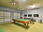 Endless entertainment awaits in the furnished garage turned into a game room!