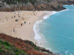 Porthcurno beach. There is a Telegraph museum here. The outdoor Minack theater is near. 45 mins.