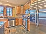 Fully Equipped Kitchen with Granite Counters, Stainless Appliances and Gas Range