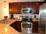 Gourmet kitchen, stainless, wood cabinetry