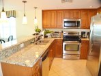 Fully equipped kitchen with upgraded cabinetry and stainless appliances
