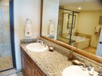 Double sinks, upgraded granite tops and cabinetry plus vanity mirror