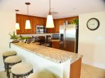 Breakfast bar with granite counter-top and additional seating