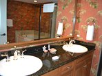 Master bath with double sinks, ceramic tiled, walk in shower and whirl pool tub