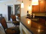 Kitchen with granite breakfast bar