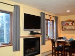 Fireplace and TV with Dining area