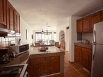 Granite and Stainless Kitchen with a view of your kids in the pool!