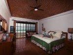 Master bedroom - king bed, TV, en suite bathroom (newly remodeled 2016) , copula ceiling & balcony