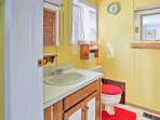 Enjoy a refreshing rinse in the en-suite bathroom that offers a walk-in shower.