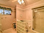 Step inside this walk-in shower to rinse off in the mornings.