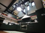 Modern kitchen with vaulted ceiling.