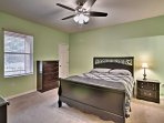 The master bedroom offers a comfortable queen-sized bed.